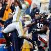 Georgia Tech's Demarius Thomas, left, catches a pass as Virginia's Corey Mosley defends during the first half of an NCAA college football game at Scott Stadium in Charlottesville, Va., on Saturday, Oct.24, 2009.  (AP Photo/Don Petersen)