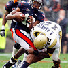 Georgia Tech's Anthony Barnes (12) stops University of Virginia's  Chase Minnifield (13) in the 2nd quarter of play at Scott Stadium in Charlottesville VA Sat. Oct. 24, 2009.