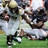 Georgia Tech's Anthony Allen gets yardage as Virginia's Vic Hall (4) tries to stop him during the first half  of an NCAA college football game at Scott Stadium in Charlottesville, Va., on Saturday, Oct.24, 2009.  (AP Photo/Don Petersen)
