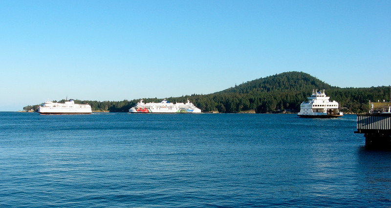 three BC ferries in action