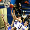 St. Michael's Horsemen Salomon Martinez, #32, goes up for a layup tduring the second quarter of their game against Lovington at  Perez-Shelley Gymnasium on Saturday, January 14, 2012.  Santo Coppola, #50 is seen in the background.<br /> <br /> Photos by Jane Phillips/The New Mexican