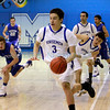 St. Michael's Horsemen Matt Barela, #3, dribbles the ball down court during the second quarter of their game against Lovington at  Perez-Shelley Gymnasium on Saturday, January 14, 2012.<br /> <br /> Photos by Jane Phillips/The New Mexican