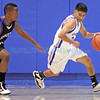 St. Mike's Wesley Vaughan, number 24, dribbles past Bosque's Jordan Tate, number 12, during the second quarter of the St. Michael's High School vs Bosque School at St. Mike's on Jan. 15, 2011.          Photos by Luis Sanchez Saturno/The New Mexican