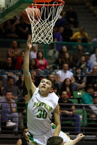 Pecos Panthers Johnny Vigil, #30, goes up for a layup during the first quarter of their game against Mesa Vista during the  Northern Rio Grande Tournament semifinals at Pojoaque Valley High School's Ben Lujan Gymnasium on Friday, January 6, 2011. Photos by Jane Phillips/the New Mexican