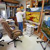 Artist Sandy Keller applies a coat of varnish to one of her finished paintings at her home workshop on Jun. 10, 2010. Keller is upset because Santa Fe County is asking her to pay for a business license even though she sells her work in a gallery on Canyon Road in the city of Santa Fe. Why? The argument is that she paints in her studio in Eldorado so is engaging in business. Keller is one of many being caught up in the county's recent efforts to make sure anyone doing business in the county is paying for a license.                Luis Sanchez Saturno/ The New Mexican.