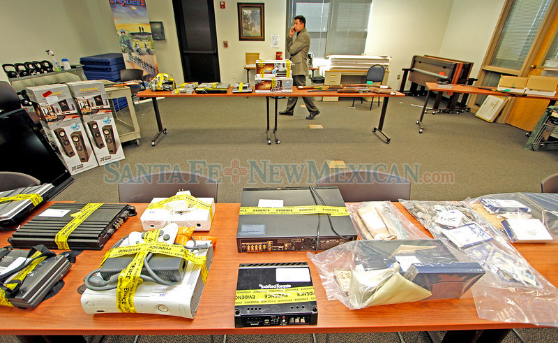 Santa Fe Police Cheif Aric Wheeler talks on the phone at the evidence room of the Santa Fe Police Station on Sep. 1, 2010, with evidence from burgleries as far back as March.             Luis Sanchez Saturno/ The New Mexican.