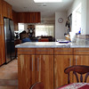 This is a view of the kitchen from the small dining area and living room.