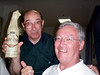Someone found Fr. Rafael a bottle of Maredsou beer which he shows off to Fr. Tom Cassidy.