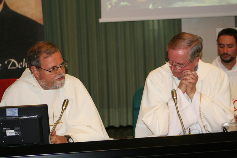 Fr. John van den Hengel (right) listens to Fr. Claudio Dalla Zuanna.