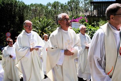 The procession, including Frs. John van den Hengel and Aquilino Mielgo