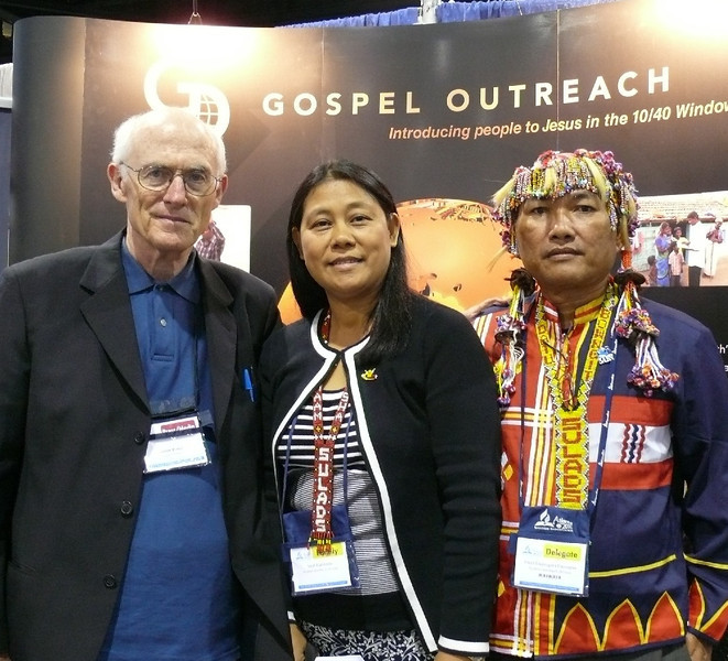 Pastor Blake at the Gospel Outreach [GO] booth with Sarah Famisaran and her  Sarah is Sarah Famisaran is the GO worker for Mindanao, in the Philippines.  Her husband, Daryl, is the SULADS director in Mindanao.  Both are strongly involved with Deaf Ministry.  The SULADS (student missionary movement) are building a school for the deaf near Mountain View SDA College in Mindanao.