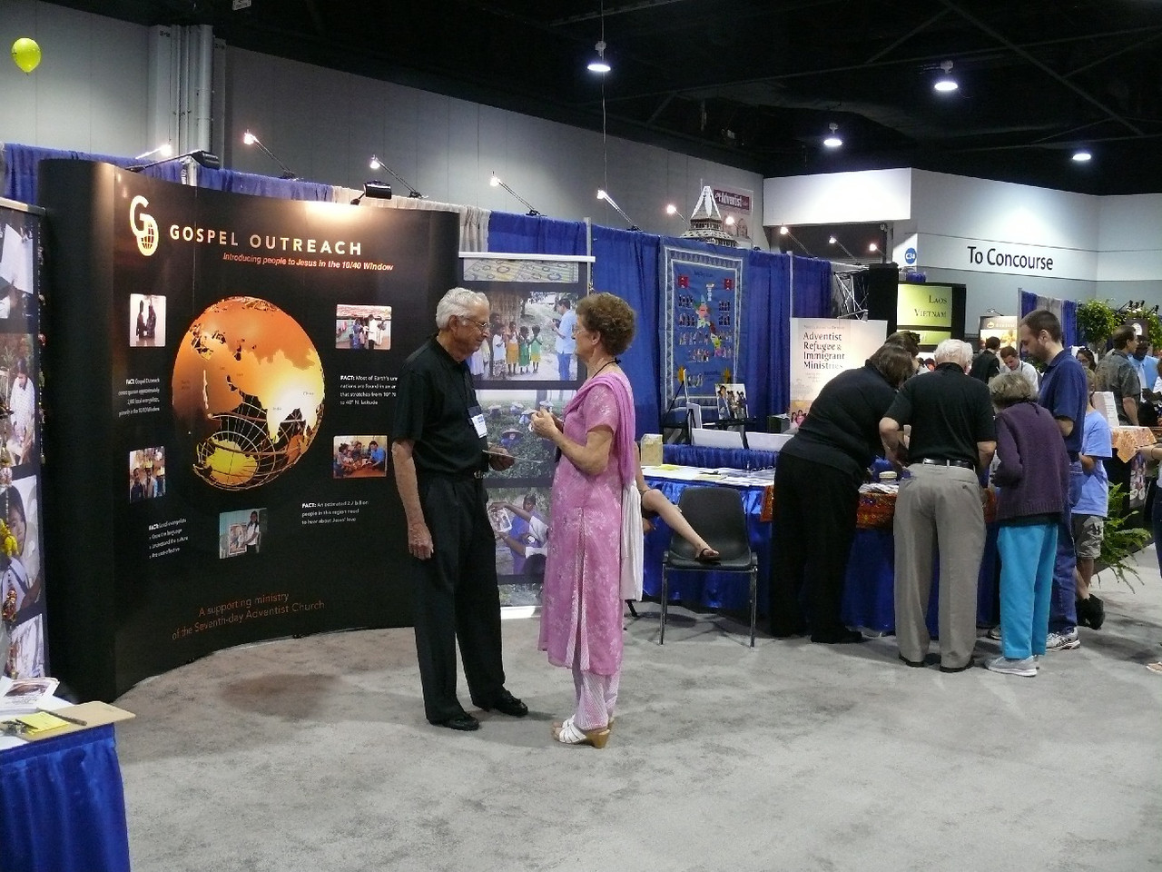 The Gospel Outreach booth where Pastor John Blake, Deaf Ministry Director, spent many hours.  Gospel Outreach has around 40 workers for the Deaf in 7 countries and about 1,800 hearing workers in over 30 countries.  Most are employees of the local Conference/Mission but sponsored by Gospel Outreach.