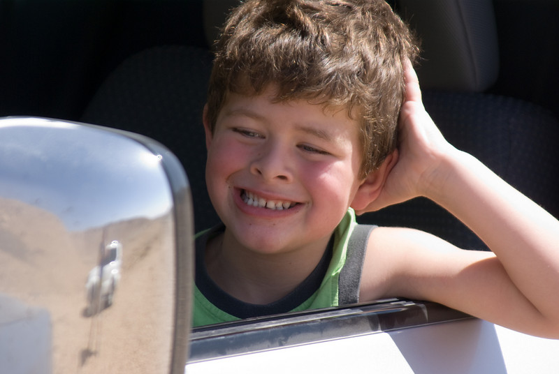So proud to have lost his first tooth! Took a few photos striking various poses, and then caught him checking himself in the side view mirror!