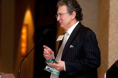 George Sinas accepts the Lawyer of the Year award in Troy, MI on March 21, 2013.
