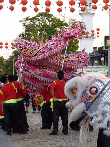 Lion and dragon dancers.  It sounds MUCH more interesting than it actually is.