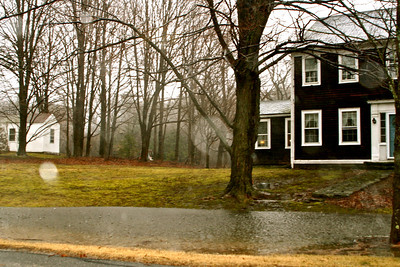 104 Elm Street, the Johnson's have a small pond on their front lawn.