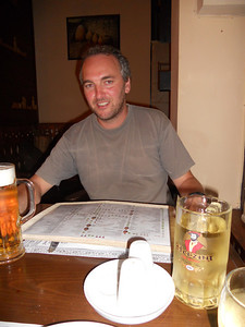Trying (and failing) to smile for the camera. All I wanted was a large cold beer (left) but first got given a half litre of white wine! (right)