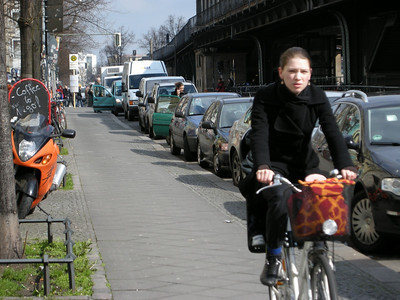 people ride bikes everywhere and there is an extensive system of bike lanes in Berlin (here) and Hamburg