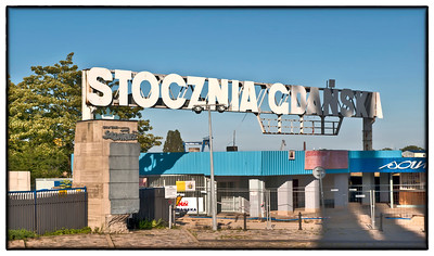 """The front gate of the former Lenin Shipyards in Gdansk, Poland. The little drop down part of the sign once said """"Lenin."""" Here, rallies were held and family members crowded around to support their striking relatives inside in the various Solidarity strikes that, in large part, led to the collapse of the East Bloc."""