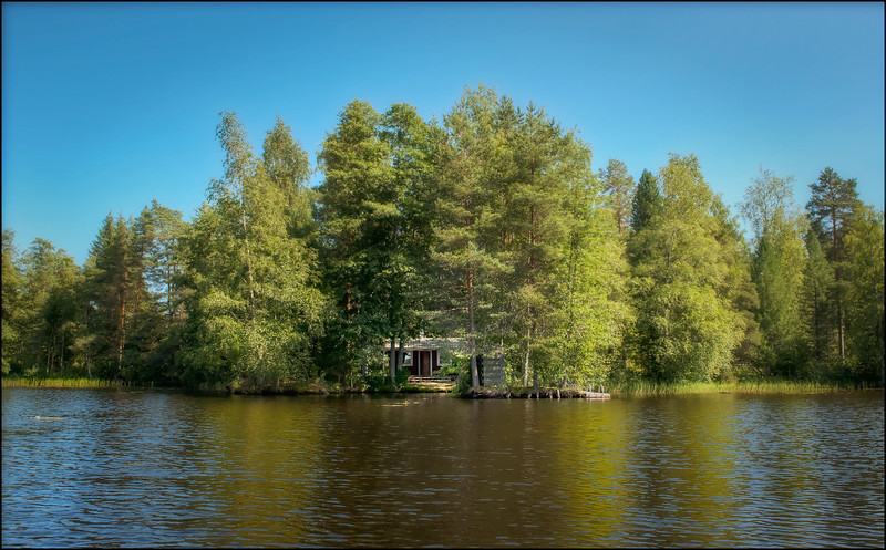 Secret sauna along the lake shore, Finland.