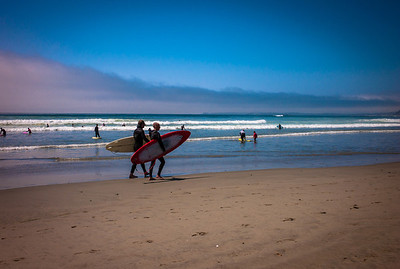 Surfers walking on the beaches of the Pacific Rim, Vancouver Island, British Columbia, Canada