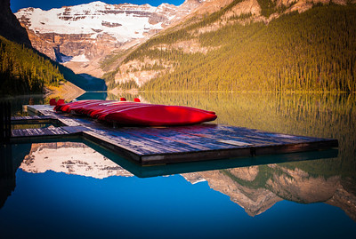 Red canoe line on deck at Lake Louise in the morning, Banff National Park, Alberta, Canada