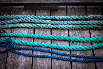 Rows of blue cable on deck of float house in Tofino, Vancouver Island, British Columbia, Canada