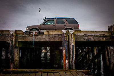 Truck and surf on main deck of port of Tofino, Vancouver Island, British Columbia, Canada