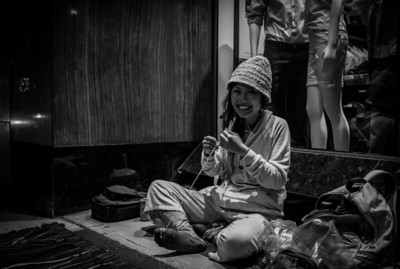 Young asian girl making bracelets in downtown Vancouver, British Columbia, Canada