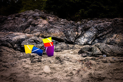 Colorful buckets on the beach of Tofino at low tide, Vancouver Island, British Columbia, Canada