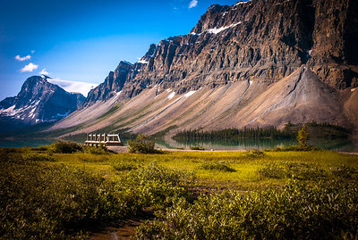 Turquoise water of Bow Lake, wood bridge and snow capped peaks, Alberta, Canada