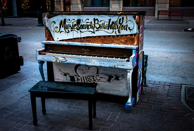 Lonely piano on sidewalk of downtown Calgary, Alberta, Canada