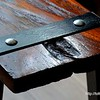 Part of an old wooden bench in a cafe at the Seenspace shopping centre in Hua Hin, Thailand in August 2017