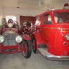 Two of the engines in the firehouse.