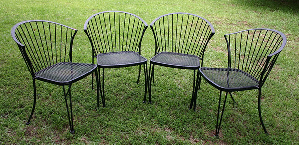 Mid-Century style outdoor chairs.  These are heavy, top quality chairs.