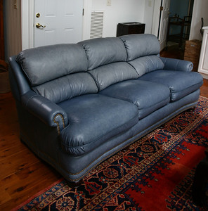 Hancock and Monroe top quality leather sofa.  As you can see, there is some fading to the top.  That can be remedied with leather balm if desired.  These are in superb condition otherwise and are luxurious sofas.