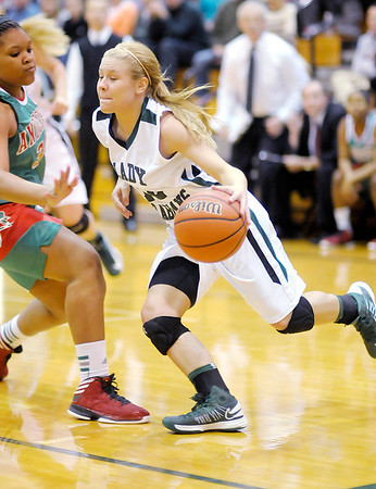 Pendleton Heights' Tiffany Wertz drives the baseline during the Girls' County Tournament Championship at Pendleton on Thursday.