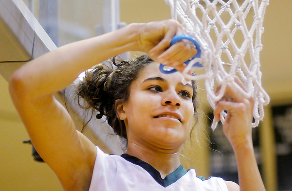 Pendleton Heights' Kiawna Cottrell cuts down a piece of the net after the Arabians beat Anderson 61-56 to win the Girls' County Tournament Championship on Thursday.