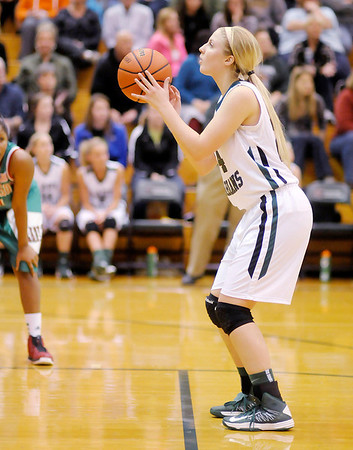 Pendleton Heights' Kenzie Gustin shoots free throws to put the Arabians up 61-56 over Anderson with 3 seconds left during the Girls' County Tournament Championship at Pendleton on Thursday.
