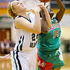 Anderson's Samia Carter draws a foul from Pendleton Heights' Kenzie Gustin  as she drives towards the basket during the Girls' County Tournament Championship at Pendleton on Thursday.