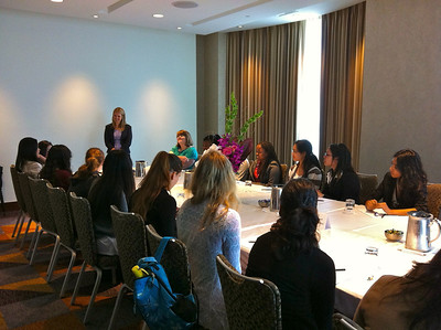 """Intercontinental Hotel, San Francisco CA, June 24, 2013.  Kristen Beck, Girls Who Code instructor (standing) warms the students up with ice-breakers as they wait to hear new Intel CEO Brian Krzanich's speech entitled: """"The Pace of Innovation."""""""