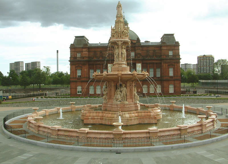 Glasgow Green - Doulton Fountain - in its new locaation in front on the Peoples Palace. The multi-storey flats of Hutchesontown in the background.