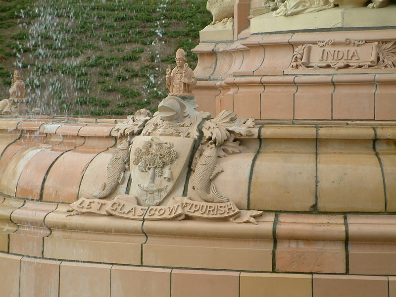 Glasgow Green - Doulton Fountain - details of the lower basin - several groups with coat of Arms and motto (part) of the City of Glasgow topped by the city's patron, Saint Mungo.