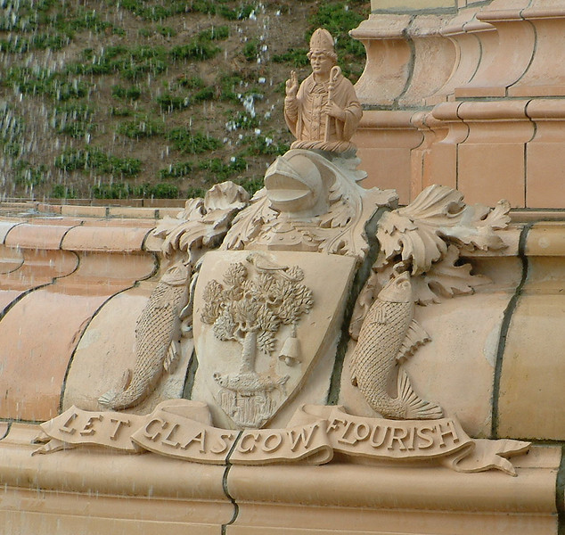 """Glasgow Green - Doulton Fountain - of the Coat of arms:<br /> There's the tree that never grew, <br /> There's the bird that never flew, <br /> There's the fish that never swam, <br /> There's the bell that never rang. <br /> <br /> see   <a href=""""http://www.rampantscotland.com/know/blknow_flourish.htm"""">http://www.rampantscotland.com/know/blknow_flourish.htm</a>"""