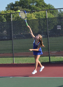Sarah Minor — sminor@shawmedia.com Shelby Fritz of Glenbard South serves the ball Monday, September 23, 2013 during her singles match against Glenbard South.