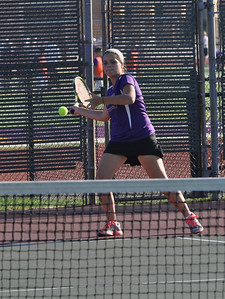 Sarah Minor — sminor@shawmedia.com Downers Grove North's Kelsey Kunz hits the ball Monday, September 23, 2013 during her doubles match against Glenbard South.