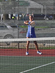 Sarah Minor — sminor@shawmedia.com Jenna Brambora of Glenbard South hits the ball Monday, September 23, 2013 during her doubles match against Glenbard South.