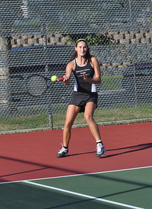 Sarah Minor — sminor@shawmedia.com Karly Weber of Downers Grove North returns a serve Monday, September 23, 2013 during their dual meet against Glenbard South.
