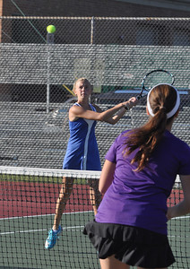 Sarah Minor — sminor@shawmedia.com Glenbard South's Rachel Pettger returns the ball Monday, September 23, 2013 during her doubles match against Downers Grove North.
