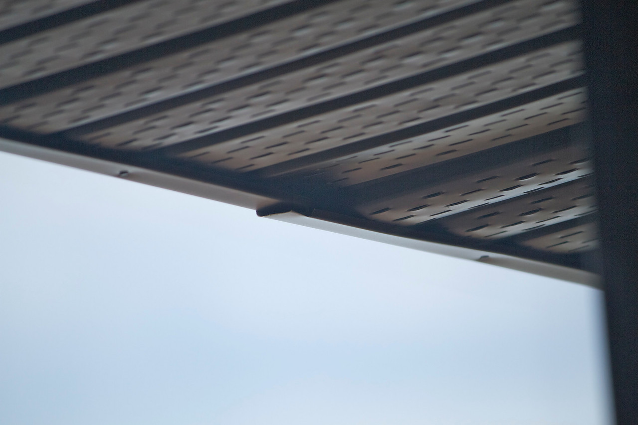 Quite a bit of the soffit was installed so as to bow it downwards.  The soffit on the right is bowed down; the soffit to the left is flatter.